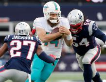 New England Patriots defenders J.C. Jackson and Dont'a Hightower pressure Miami Dolphins QB Ryan Fitzpatrick