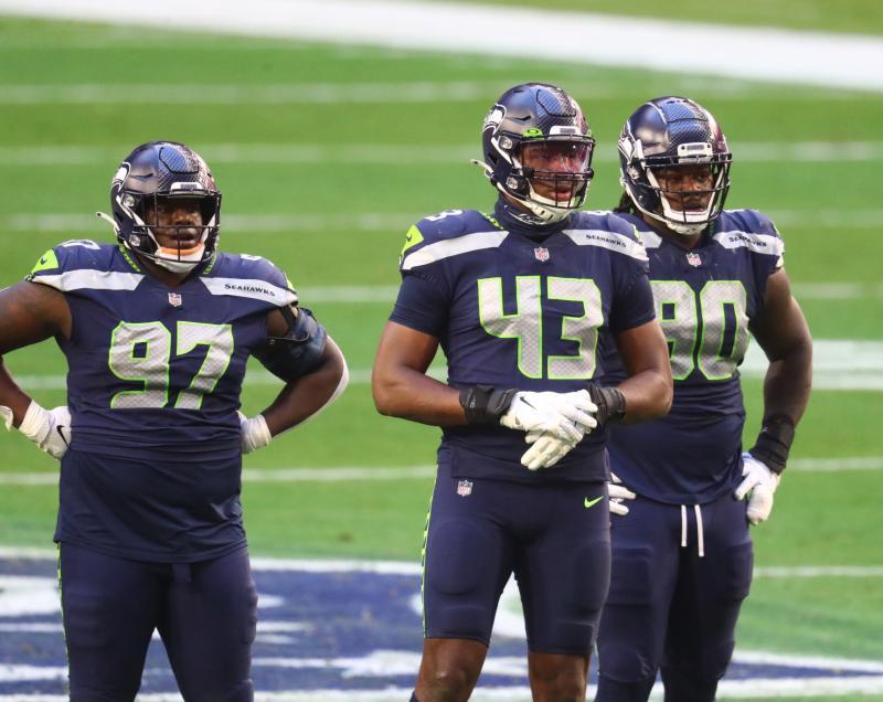 Seattle Seahawks DL Poona Ford, Carlos Dunlap, and Jarran Reed