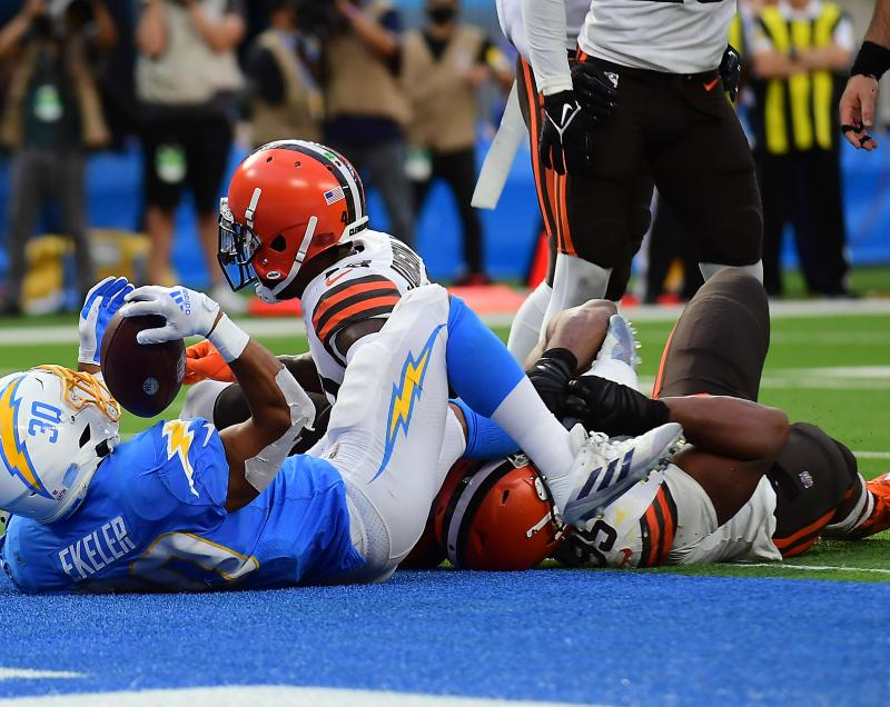 Austin Ekeler is pushed into the endzone